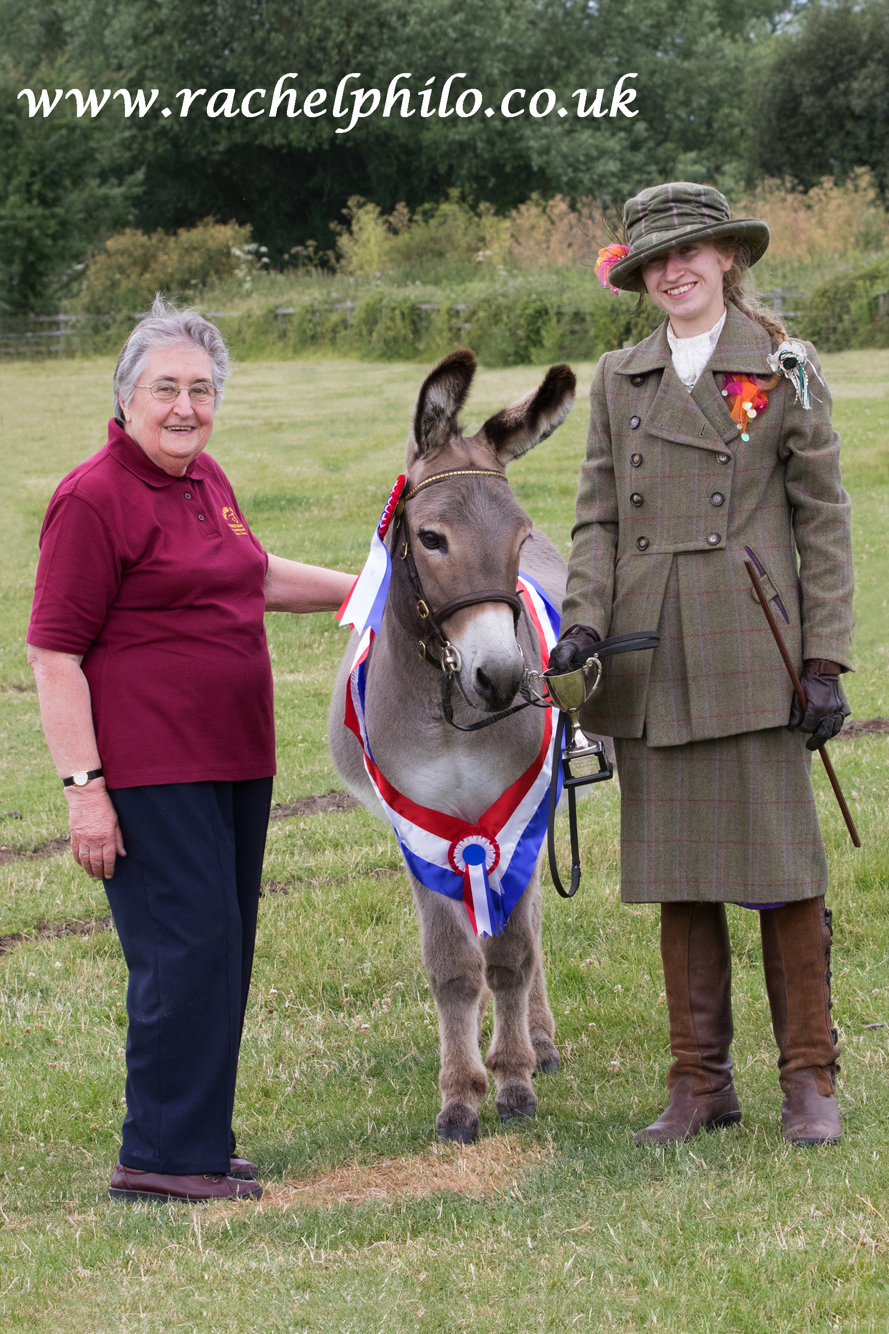 Judy Gibbons (left), Chair of Trustees, with the In Hand Champion donkey Gamlingay the Alchemist and handler Jade Weaver